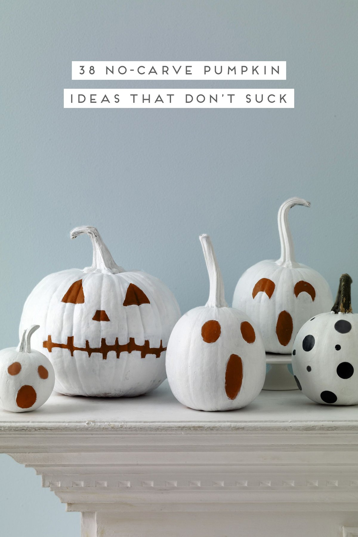 Image of no-carve pumpkins using white paint to create quirky pumpkin faces.