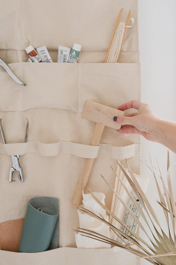 Organizing craft supplies in DIY wall organizer made of heavyweight canvas