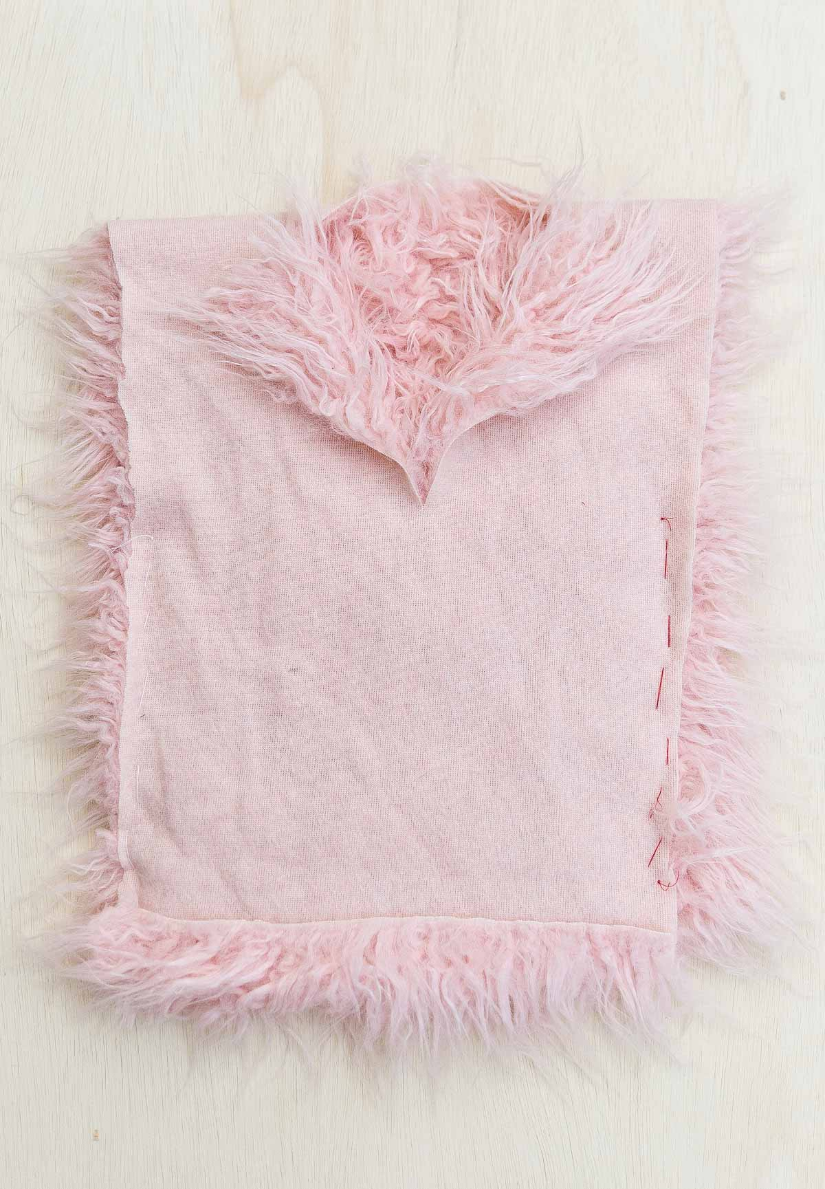 Pink faux fur being made into a bird costume.