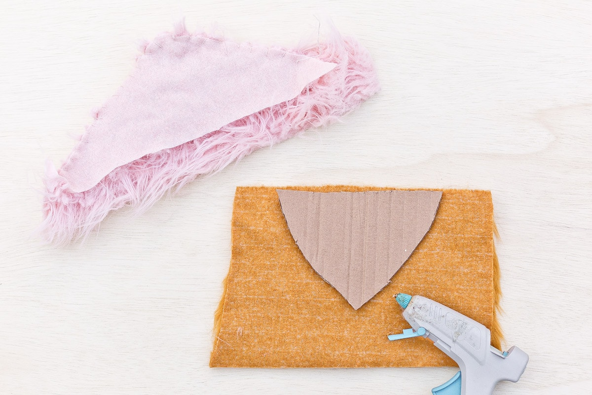 Image of faux fur being made into wings for Halloween bird costume.