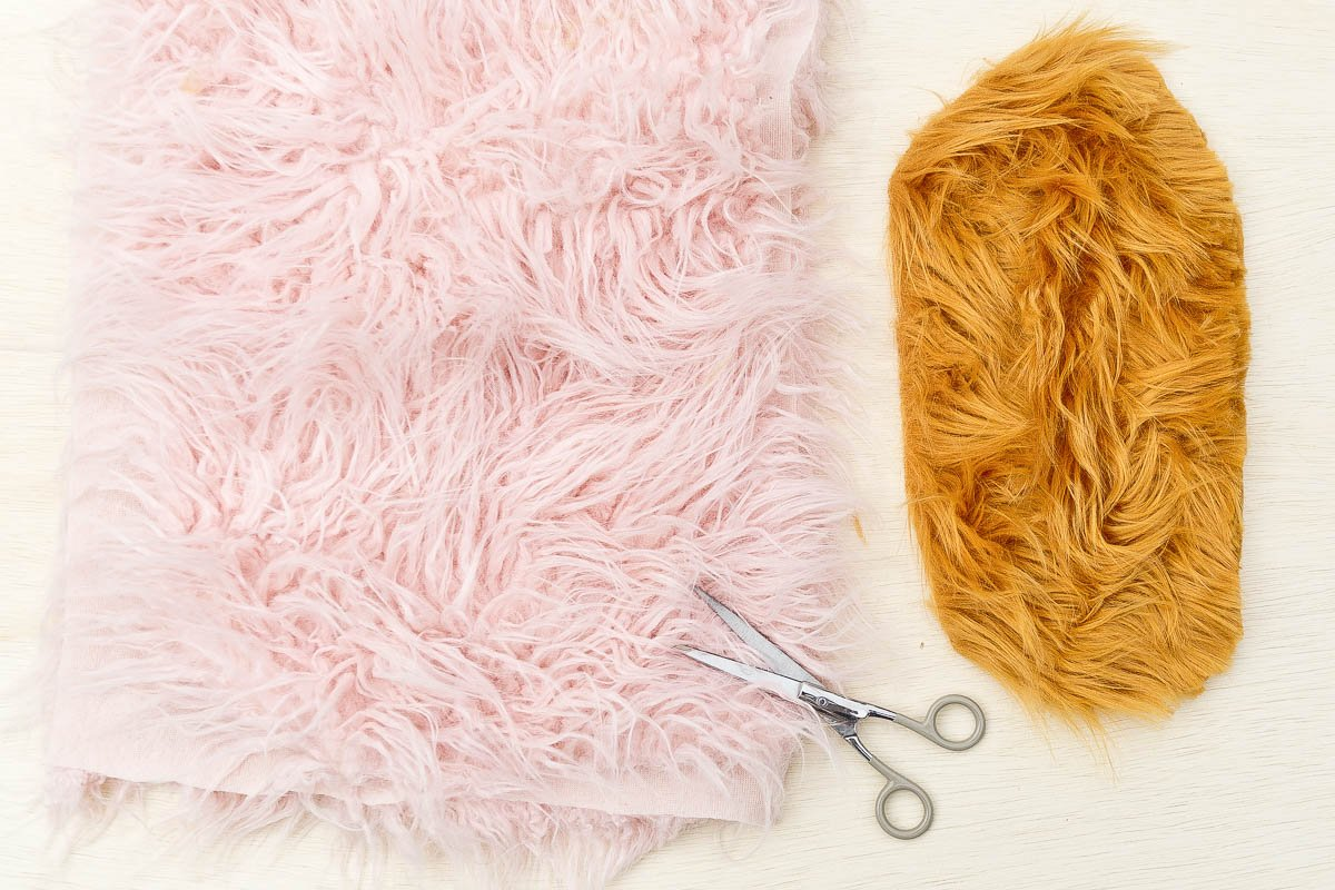 Pink and yellow faux fur with scissors.