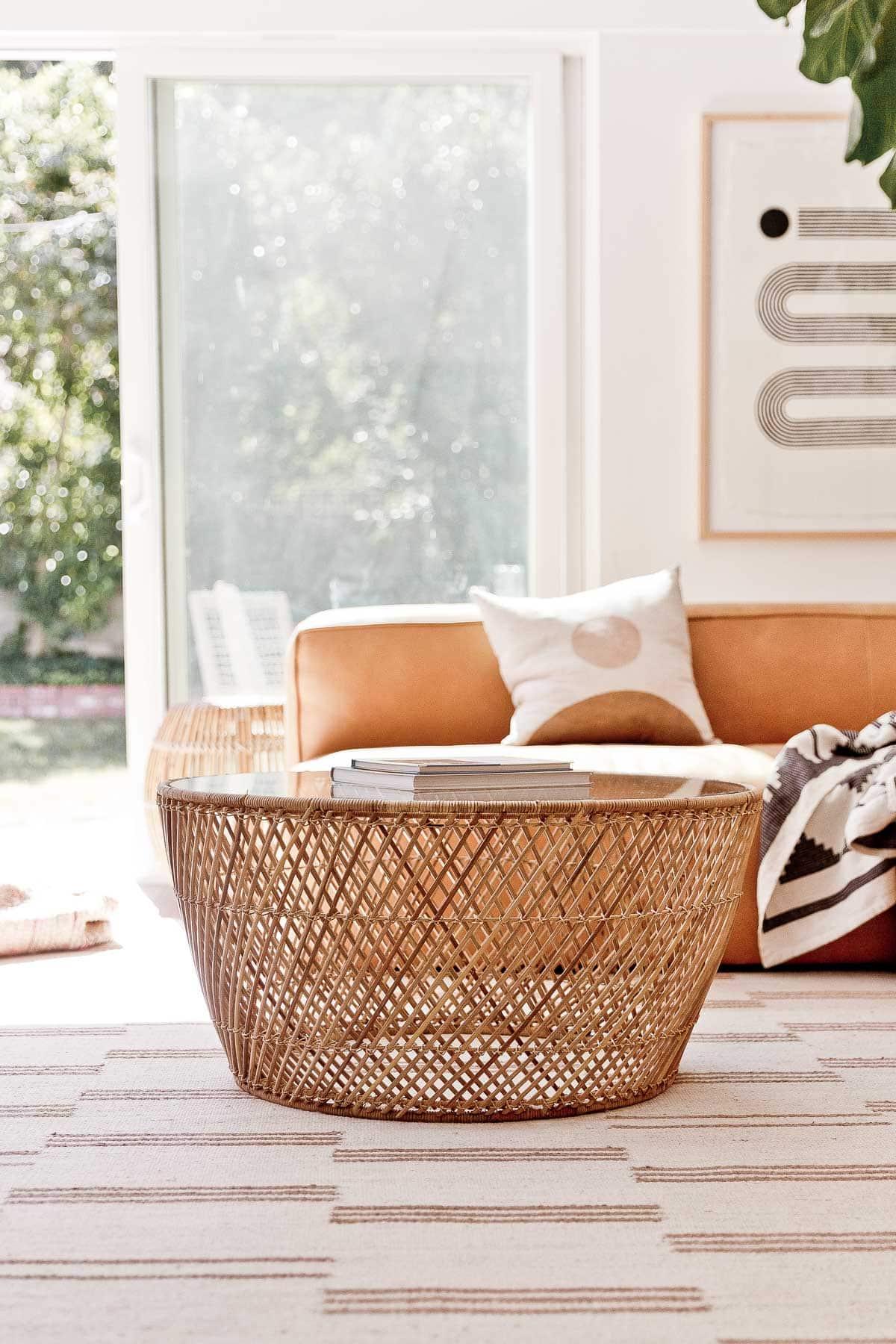 Closeup photo of Article furniture (wicker, bohemian coffee table) in modern, California home.