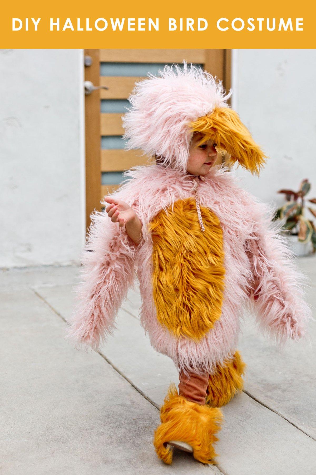 Child wearing pink and yellow homemade bird costume