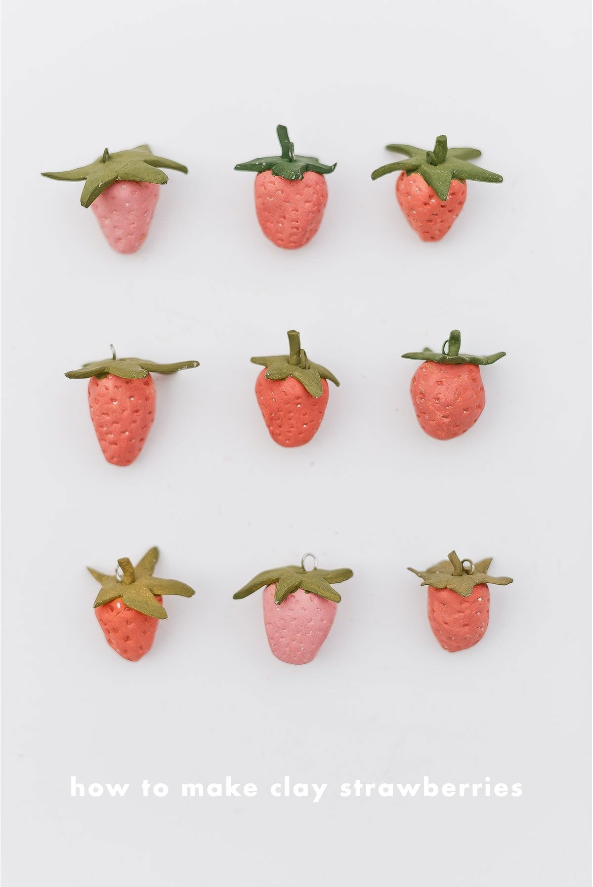 DIY clay strawberries, all lined up.