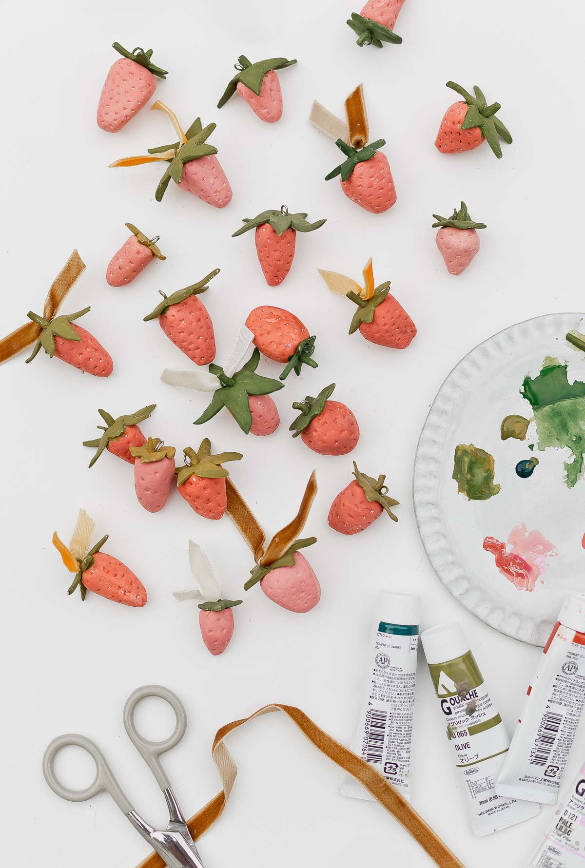 Clay strawberries with paint palette nearby.