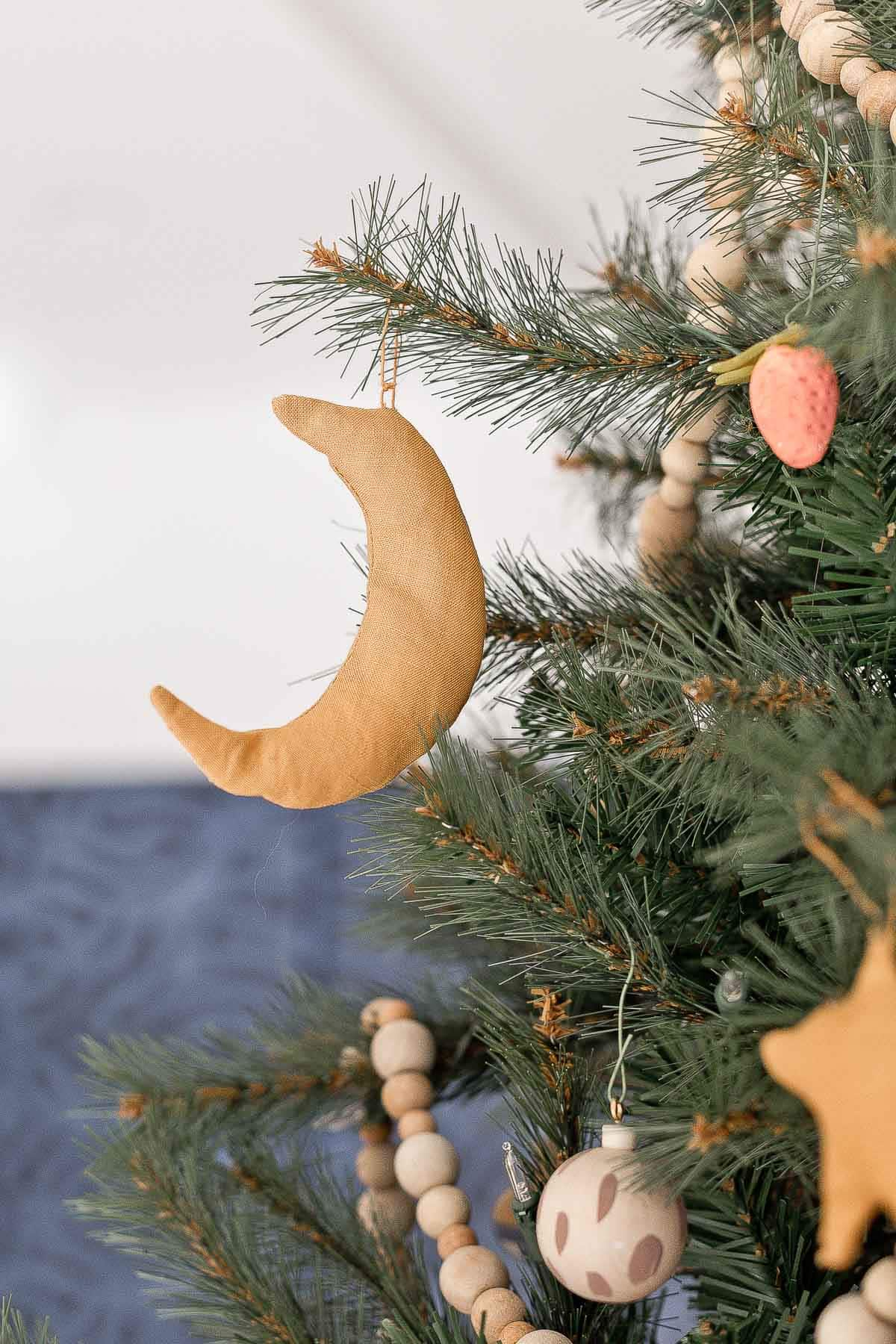 Moon ornament hanging on a Christmas tree