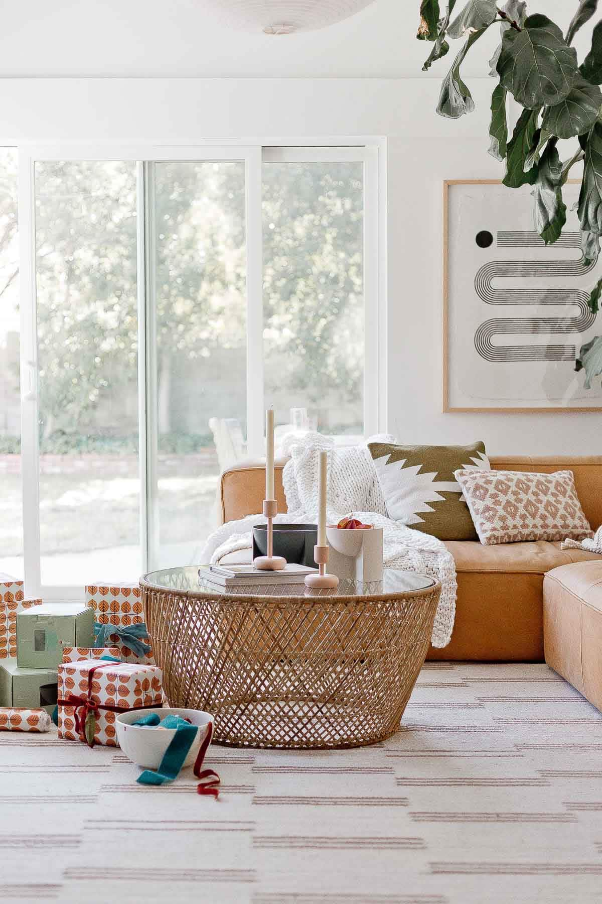 Winter home accessories and wrapped gifts for the holidays in a bohemian living room.