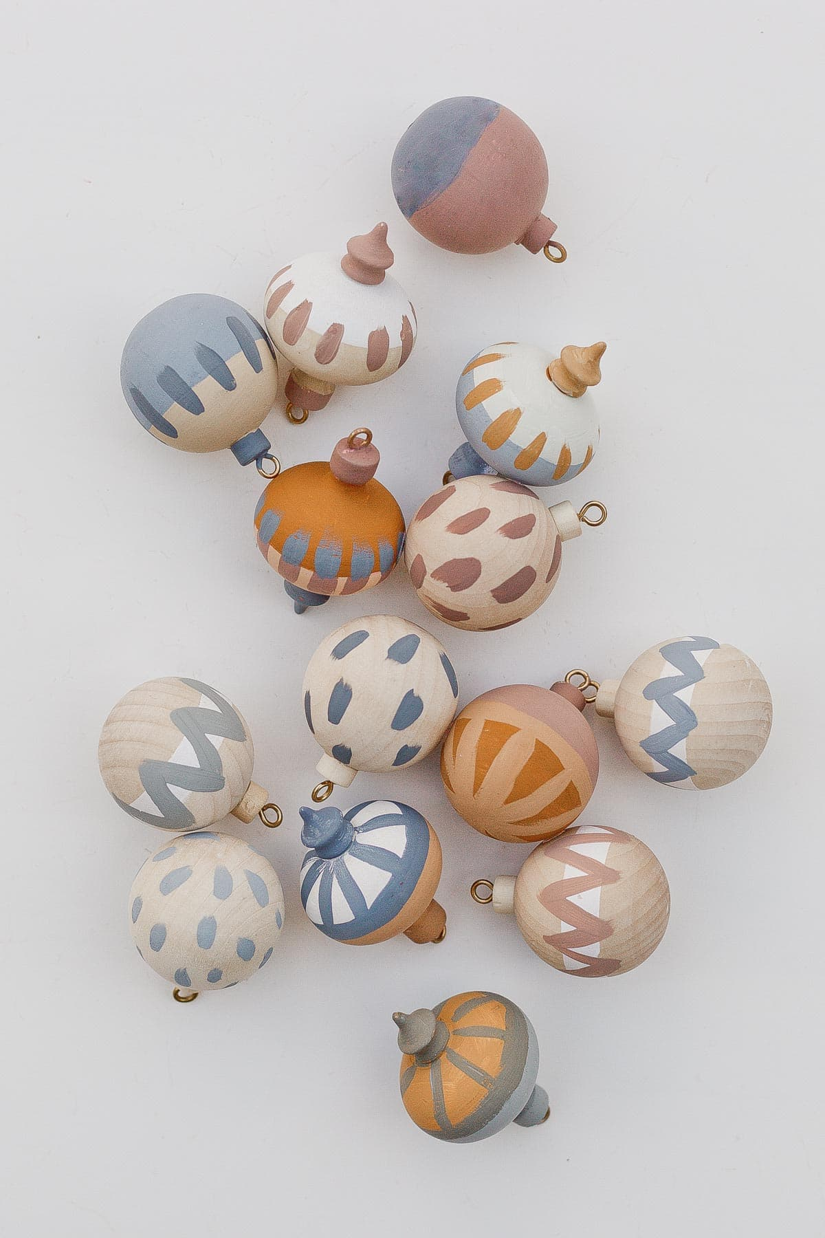 Minimal painted wood ornaments in earth tones.
