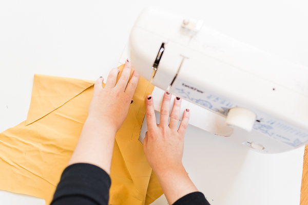 Sewing gold fabric for star pillow