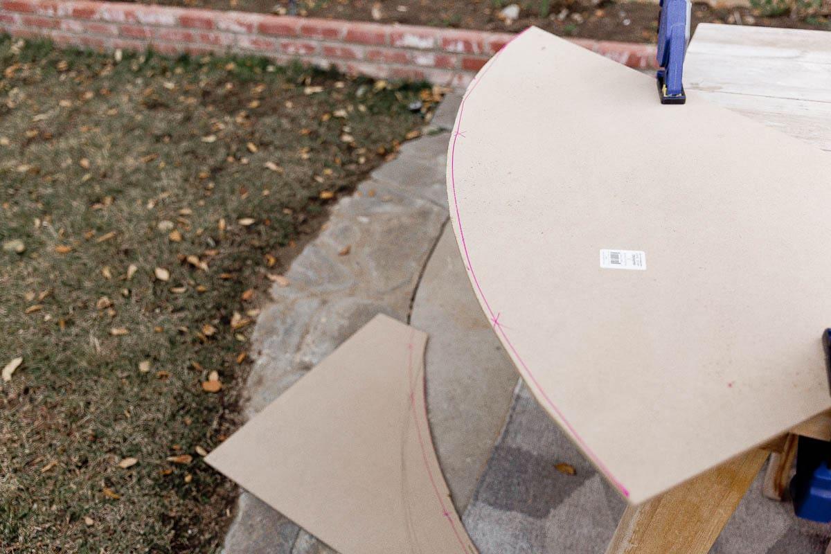 Cutting MDF panels with a jigsaw to make a DIY headboard.
