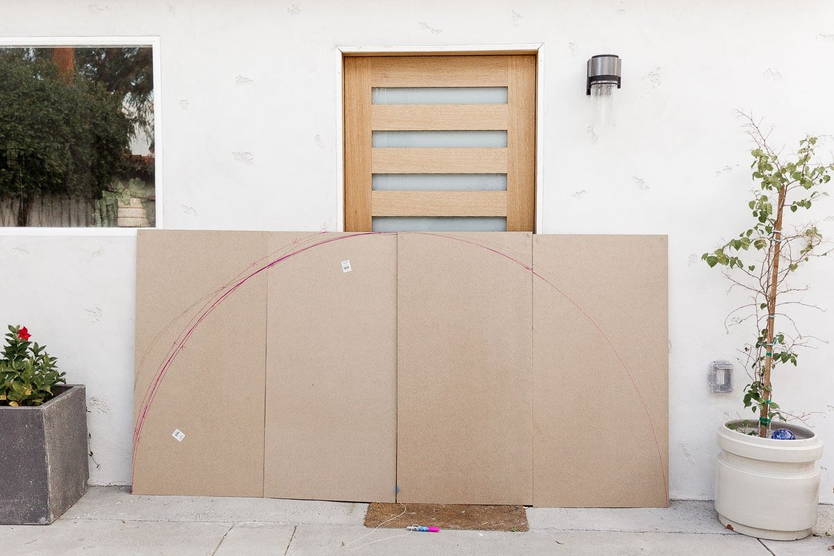 Drawing out half circle headboard on MDF panels.