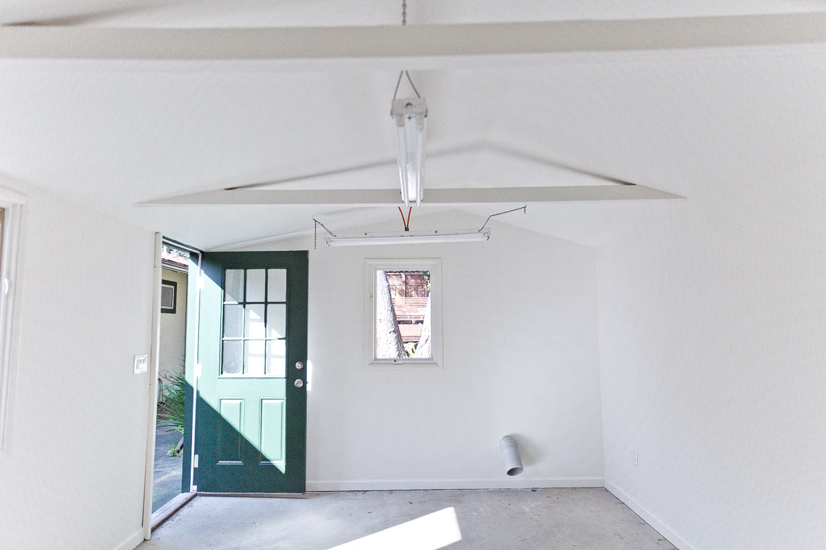 Photo of all-white, empty home office space.