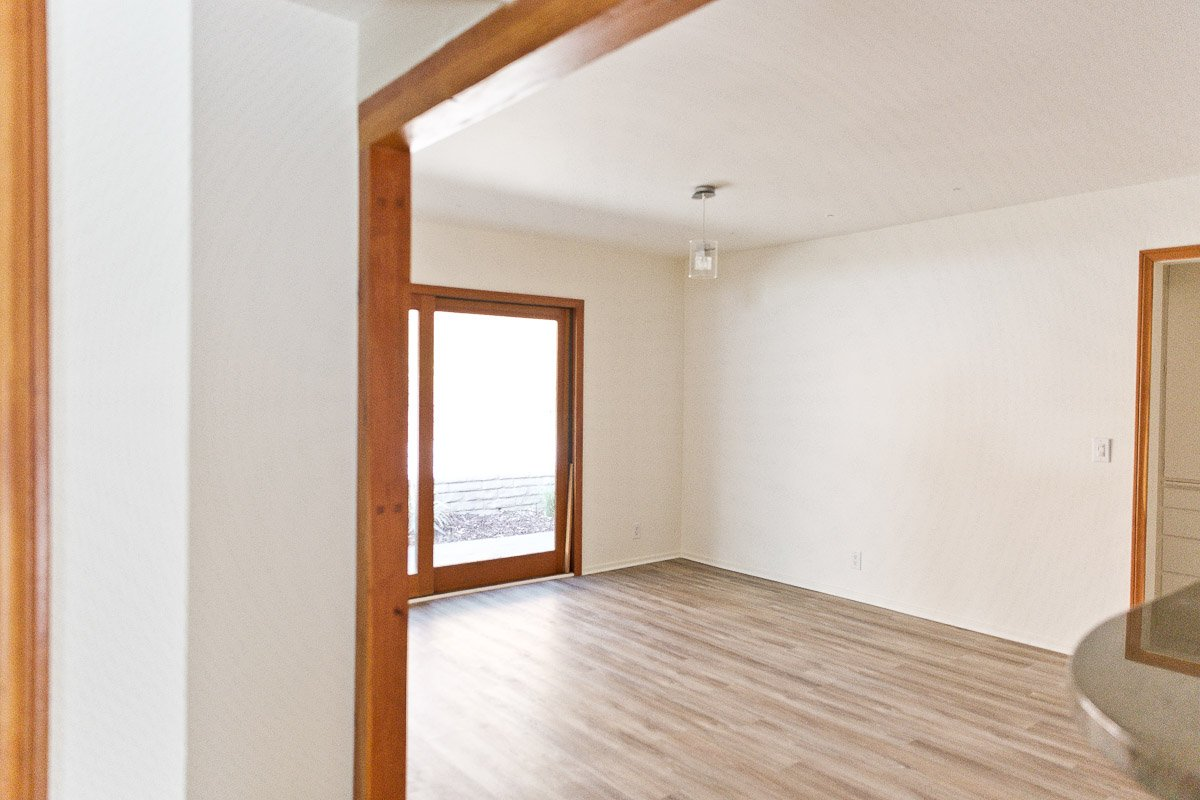 Photo of empty dining room in smaller 60s home.