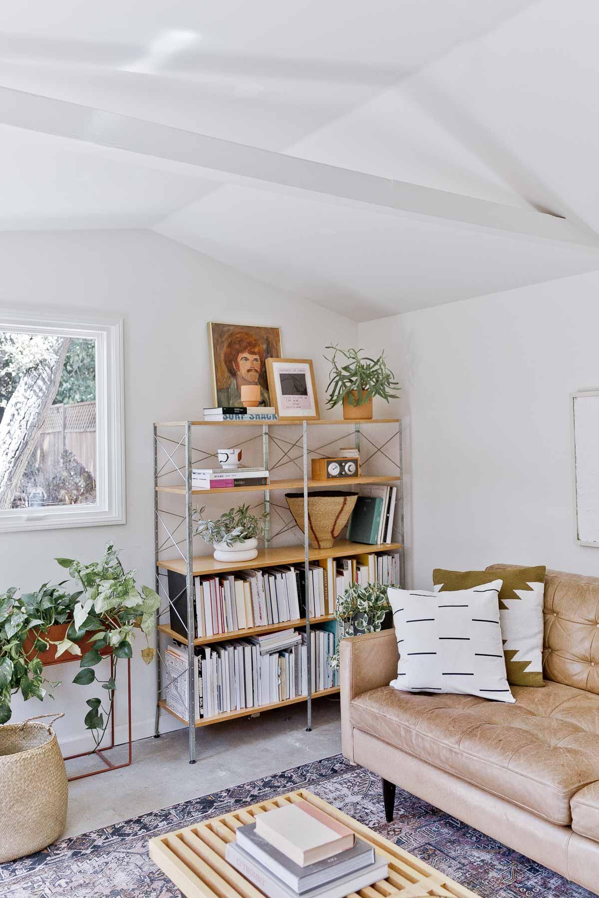 Styled book shelf in organic modern loft space.