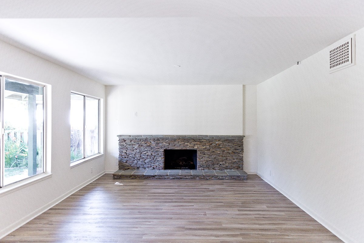 empty house with ledger rock fireplace