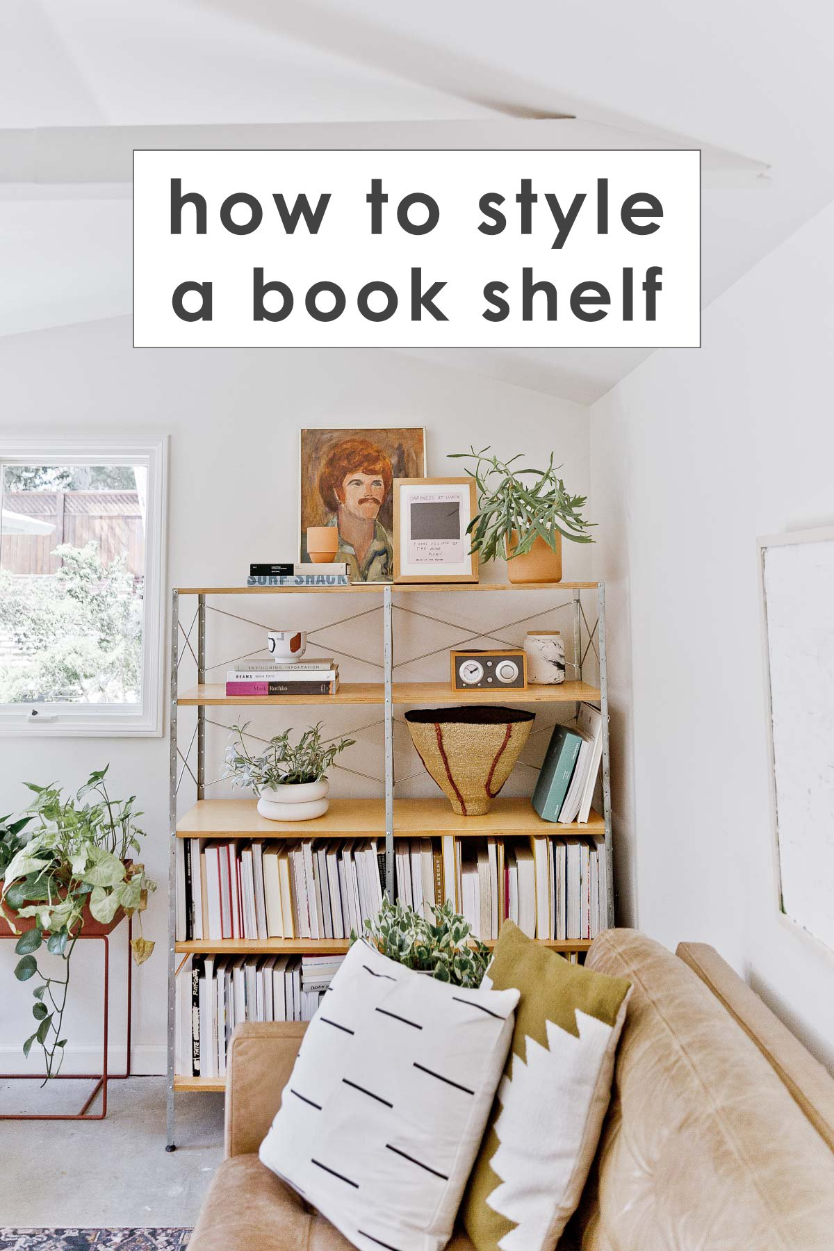 mid-century wood bookshelf in modern living room with text overlay