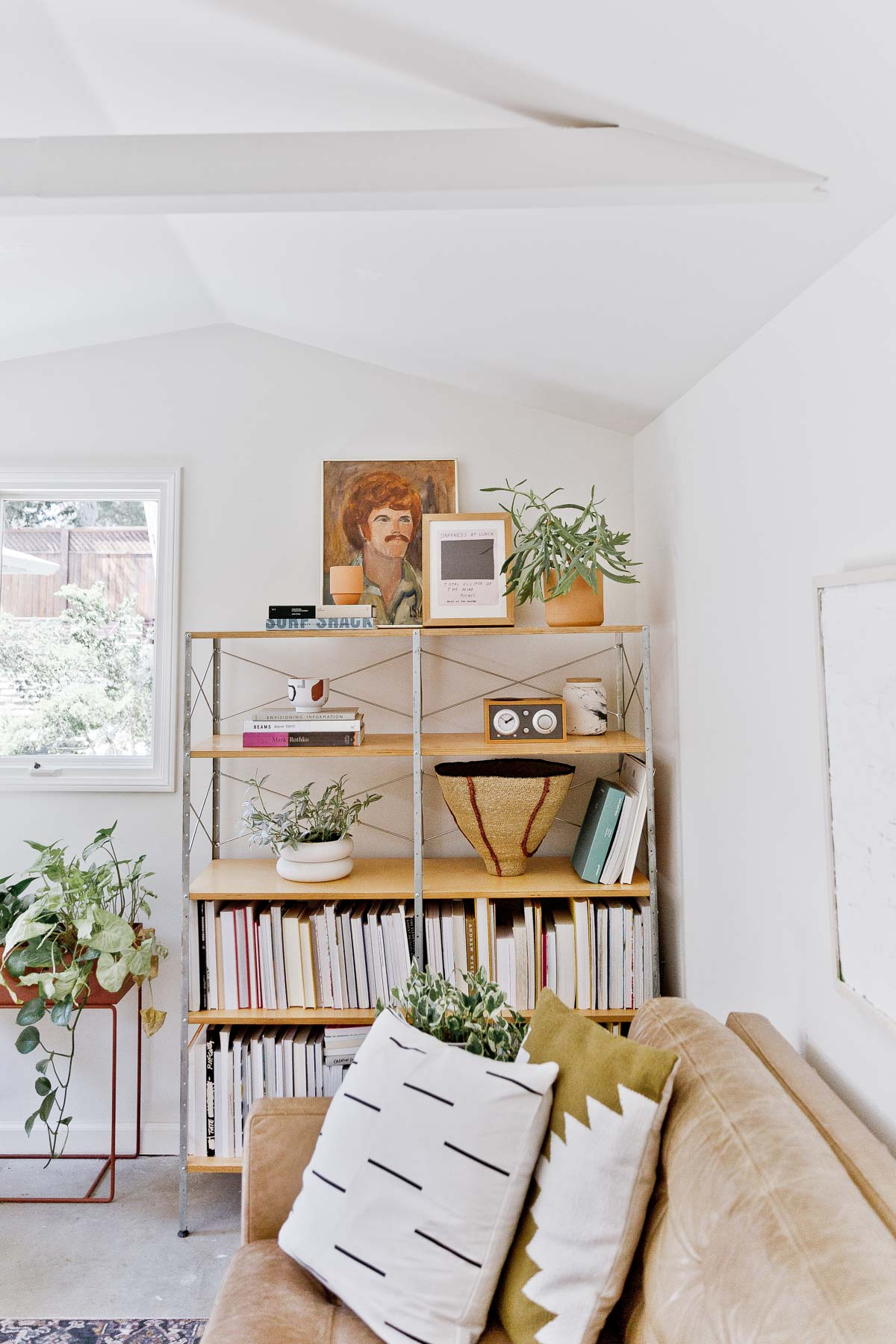 book shelves styled with books on the bottom shelves and decorative items on top shelves