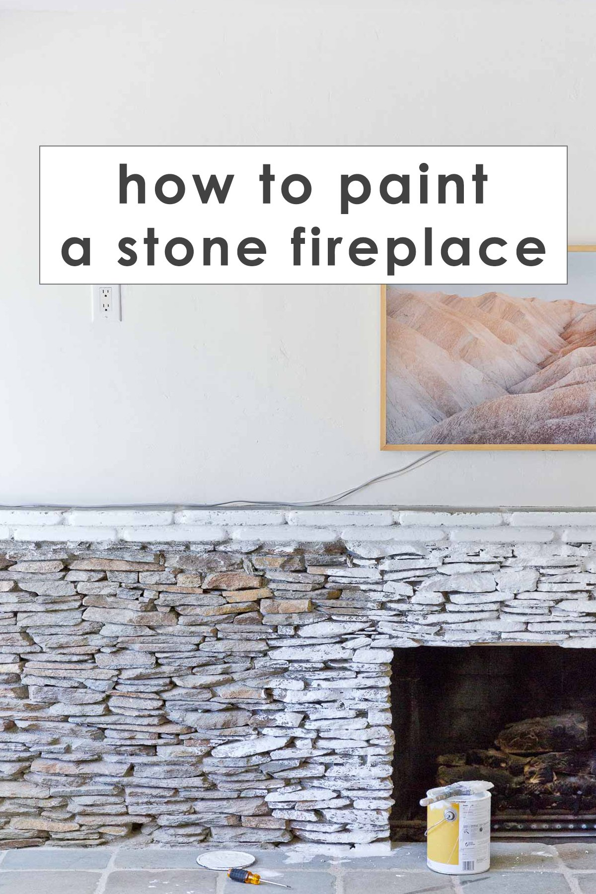 halfway painted stacked stone fireplace in white, with text overlay