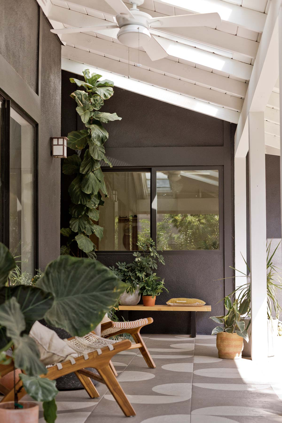 Modern front porch with dark walls and pattern tile floors.