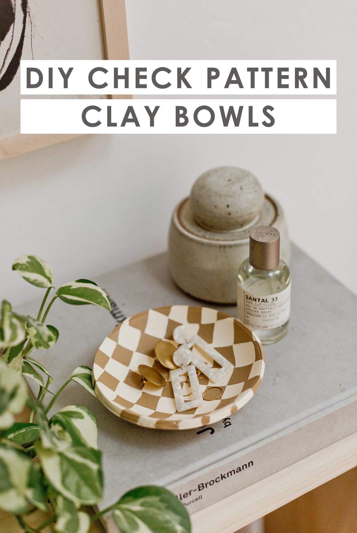 Closeup of check print clay bowls with earrings inside.