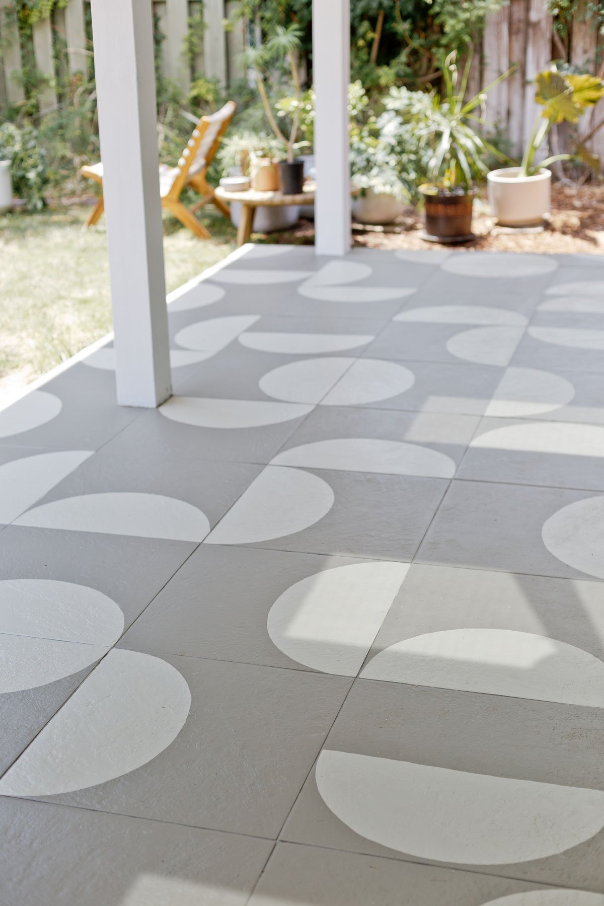Painted and stenciled geometric pattern tiles in modern, grey and white pattern.